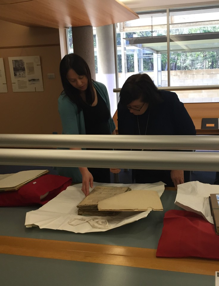Minister Enoch inspecting land records with Andrea Everitt from the Community and Personal Histories Unit of the Department of Aboriginal and Torres Strait Islander Partnerships